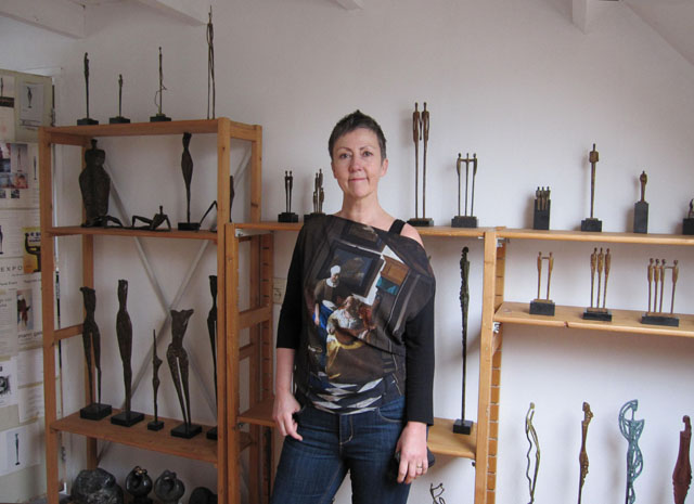 Artist and her bronze sculptures